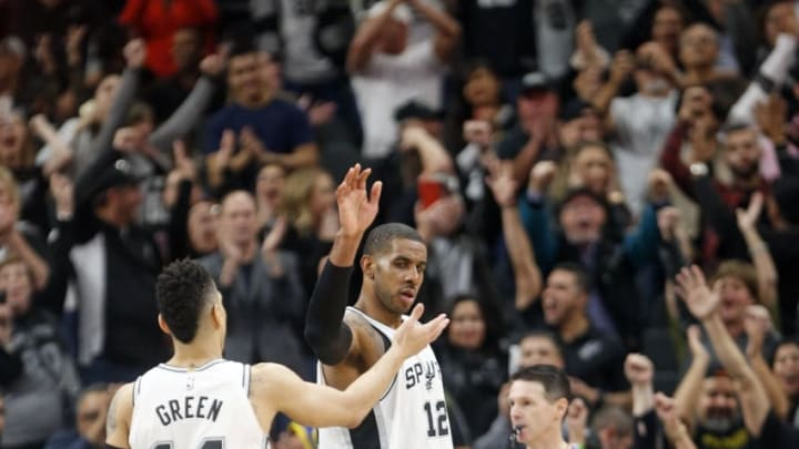 SAN ANTONIO,TX - JANUARY 30 : LaMarcus Aldridge #12 of the San Antonio Spurs high fives Danny Green #14 of the San Antonio Spurs after defeating Denver Nuggets at AT&T Center on January 28, 2018 in San Antonio, Texas. NOTE TO USER: User expressly acknowledges and agrees that , by downloading and or using this photograph, User is consenting to the terms and conditions of the Getty Images License Agreement. (Photo by Ronald Cortes/Getty Images)