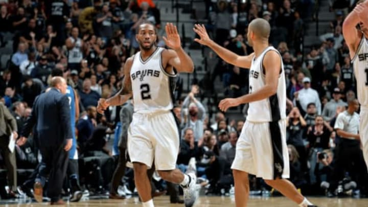 SAN ANTONIO, TX – JANUARY 17: Kawhi Leonard #2 and Manu Ginobili #20 of the San Antonio Spurs high fives each other during the game against the Minnesota Timberwolves on January 17, 2017 at the AT&T Center in San Antonio, Texas. NOTE TO USER: User expressly acknowledges and agrees that, by downloading and or using this photograph, user is consenting to the terms and conditions of the Getty Images License Agreement. Mandatory Copyright Notice: Copyright 2017 NBAE (Photos by Mark Sobhani/NBAE via Getty Images)