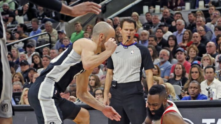 SAN ANTONIO,TX - FEBRUARY 01: James Harden #13 of the Houston Rockets goes down as Danny Green #14 of the San Antonio Spurs tries to tie him up at AT&T Center on January 28, 2018 in San Antonio, Texas. NOTE TO USER: User expressly acknowledges and agrees that , by downloading and or using this photograph, User is consenting to the terms and conditions of the Getty Images License Agreement. (Photo by Ronald Cortes/Getty Images)