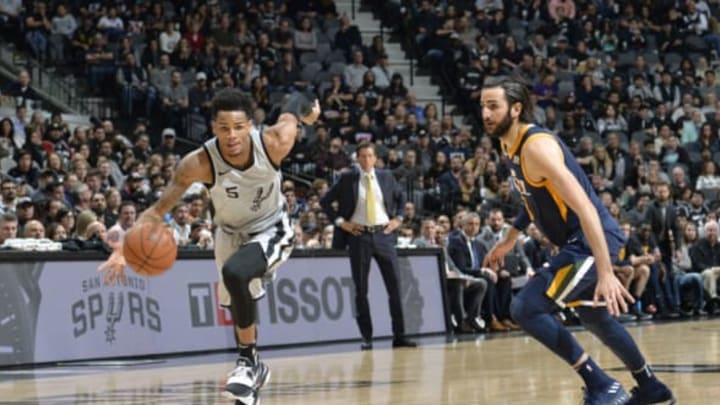 SAN ANTONIO, TX – FEBRUARY 3: Dejounte Murray #5 of the San Antonio Spurs handles the ball against Ricky Rubio #3 of the Utah Jazz on February 3, 2018 at the AT&T Center in San Antonio, Texas. NOTE TO USER: User expressly acknowledges and agrees that, by downloading and or using this photograph, user is consenting to the terms and conditions of the Getty Images License Agreement. Mandatory Copyright Notice: Copyright 2018 NBAE (Photos by Mark Sobhani/NBAE via Getty Images)