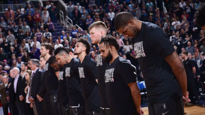 PHOENIX, AZ - FEBRUARY 7: the San Antonio Spurs stand for the national anthem prior to the game against the Phoenix Suns on February 7, 2018 at Talking Stick Resort Arena in Phoenix, Arizona. NOTE TO USER: User expressly acknowledges and agrees that, by downloading and or using this photograph, user is consenting to the terms and conditions of the Getty Images License Agreement. Mandatory Copyright Notice: Copyright 2018 NBAE (Photo by Michael Gonzales/NBAE via Getty Images)