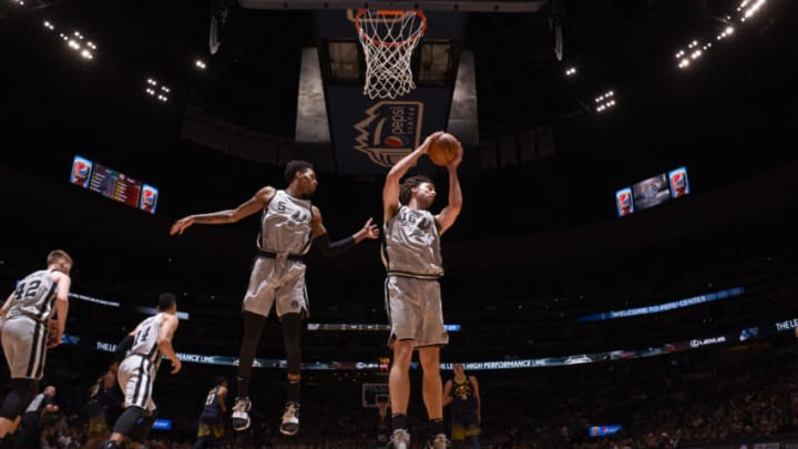 DENVER, CO - FEBRUARY 13: Pau Gasol #16 of the San Antonio Spurs grabs the rebound against the Denver Nuggets on February 13, 2018 at the Pepsi Center in Denver, Colorado. NOTE TO USER: User expressly acknowledges and agrees that, by downloading and/or using this photograph, user is consenting to the terms and conditions of the Getty Images License Agreement. Mandatory Copyright Notice: Copyright 2018 NBAE (Photo by Garrett Ellwood/NBAE via Getty Images)