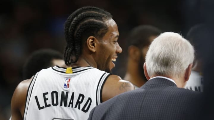 SAN ANTONIO,TX - APRIL 19: Kawhi Leonard #2 of the San Antonio Spurs shares a laugh with head coach Gregg Popovich of game two of the Western Conference Quarterfinals during the 2016 NBA Playoffs at AT&T Center on April 19, 2016 in San Antonio, Texas. NOTE TO USER: User expressly acknowledges and agrees that , by downloading and or using this photograph, User is consenting to the terms and conditions of the Getty Images License Agreement. (Photo by Ronald Cortes/Getty Images)