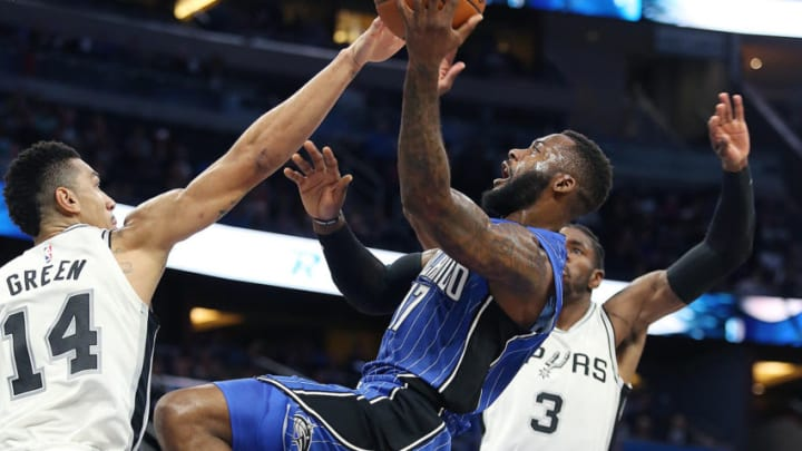 The Orlando Magic's Jonathon Simmons (17) shoots past the San Antonio Spurs' Danny Green (14) and Brandon Paul (3) during the first half at the Amway Center in Orlando, Fla., on Friday, Oct. 27, 2017. (Stephen M. Dowell/Orlando Sentinel/TNS via Getty Images)