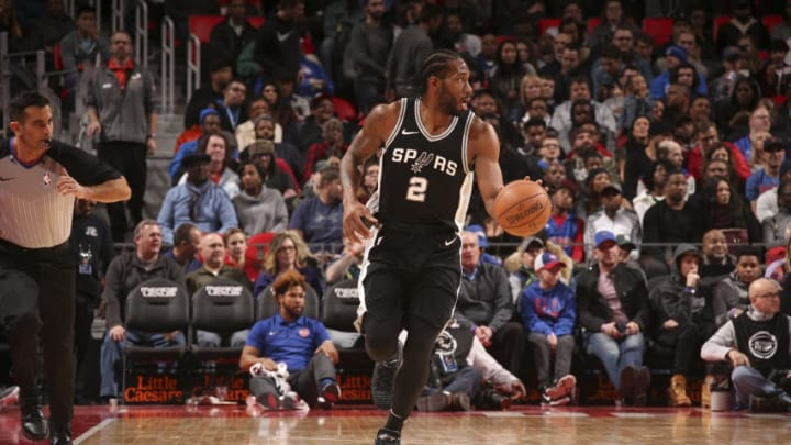 DETROIT, MI - DECEMBER 30: Kawhi Leonard #2 of the San Antonio Spurs handles the ball against the Detroit Pistons on December 30, 2017 at Little Caesars Arena in Detroit, Michigan. NOTE TO USER: User expressly acknowledges and agrees that, by downloading and/or using this photograph, User is consenting to the terms and conditions of the Getty Images License Agreement. Mandatory Copyright Notice: Copyright 2017 NBAE (Photo by Brian Sevald/NBAE via Getty Images)