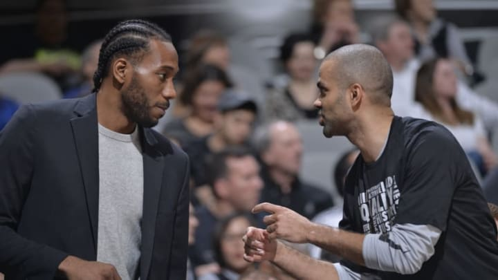 SAN ANTONIO, TX - FEBRUARY 28: Kawhi Leonard #2 of the San Antonio Spurs talks with Tony Parker #9 of the San Antonio Spurs during the game against the New Orleans Pelicans on February 28, 2018 at the AT&T Center in San Antonio, Texas. NOTE TO USER: User expressly acknowledges and agrees that, by downloading and or using this photograph, user is consenting to the terms and conditions of the Getty Images License Agreement. Mandatory Copyright Notice: Copyright 2018 NBAE (Photos by Mark Sobhani/NBAE via Getty Images)