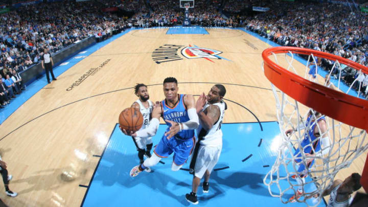 OKLAHOMA CITY, OK - MARCH 10: Russell Westbrook #0 of the Oklahoma City Thunder drives to the basket against the San Antonio Spurs on March 10, 2018 at Chesapeake Energy Arena in Oklahoma City, Oklahoma. NOTE TO USER: User expressly acknowledges and agrees that, by downloading and or using this photograph, User is consenting to the terms and conditions of the Getty Images License Agreement. Mandatory Copyright Notice: Copyright 2018 NBAE (Photo by Layne Murdoch/NBAE via Getty Images)