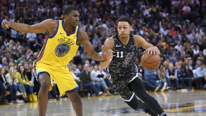 OAKLAND, CA - MARCH 08: Bryn Forbes #11 of the San Antonio Spurs drives on Kevon Looney #5 of the Golden State Warriors during an NBA basketball game at ORACLE Arena on March 8, 2018 in Oakland, California. NOTE TO USER: User expressly acknowledges and agrees that, by downloading and or using this photograph, User is consenting to the terms and conditions of the Getty Images License Agreement. (Photo by Thearon W. Henderson/Getty Images)