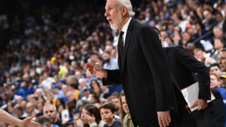 OAKLAND, CA - MARCH 8: Head Coach Gregg Popovich of the San Antonio Spurs looks on during the game against the Golden State Warriors on March 8, 2018 at ORACLE Arena in Oakland, California. NOTE TO USER: User expressly acknowledges and agrees that, by downloading and or using this photograph, user is consenting to the terms and conditions of Getty Images License Agreement. Mandatory Copyright Notice: Copyright 2018 NBAE (Photo by Garrett Ellwood/NBAE via Getty Images)