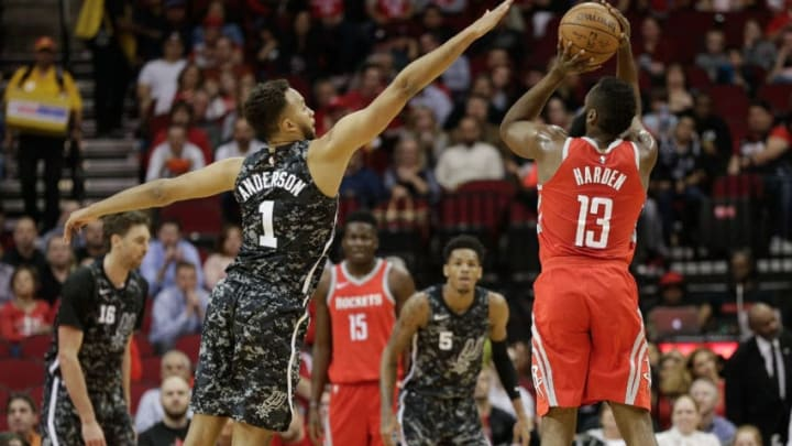 HOUSTON, TX - MARCH 12: James Harden #13 of the Houston Rockets shoots a three point basket over Kyle Anderson #1 of the San Antonio Spurs at Toyota Center on March 12, 2018 in Houston, Texas. NOTE TO USER: User expressly acknowledges and agrees that, by downloading and or using this photograph, User is consenting to the terms and conditions of the Getty Images License Agreement. (Photo by Bob Levey/Getty Images)