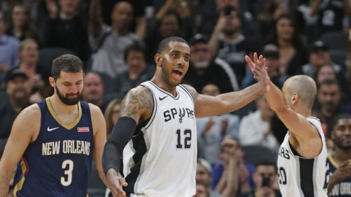 SAN ANTONIO,TX - MARCH 15: LaMarcus Aldridge #12 of the San Antonio Spurs celebrates with Manu Ginobili #20 of the San Antonio Spurs as Nikola Mitotic #3 of the New Orleans Pelicans hangs his head in closing seconds of game at AT&T Center on March 15, 2018 in San Antonio, Texas. NOTE TO USER: User expressly acknowledges and agrees that , by downloading and or using this photograph, User is consenting to the terms and conditions of the Getty Images License Agreement. (Photo by Ronald Cortes/Getty Images)