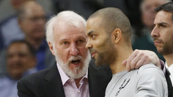 SAN ANTONIO,TX - MARCH 15: Gregg Popvich head coach of the San Antonio Spurs talks with Tony Parker #9 of the San Antonio Spurs during game against the New Orleans Pelicans at AT&T Center on March 15, 2018 in San Antonio, Texas. NOTE TO USER: User expressly acknowledges and agrees that , by downloading and or using this photograph, User is consenting to the terms and conditions of the Getty Images License Agreement. (Photo by Ronald Cortes/Getty Images)