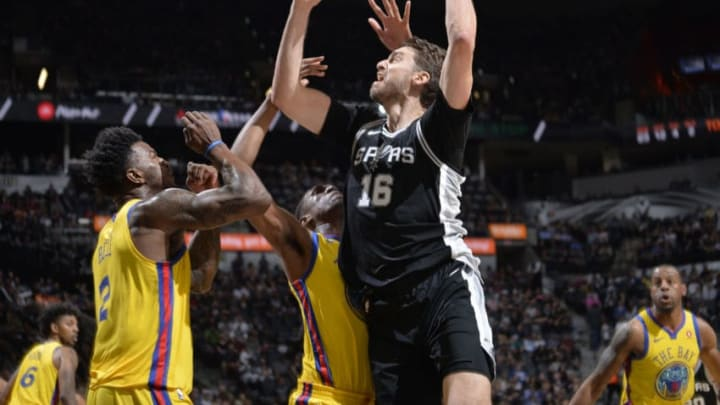 SAN ANTONIO, TX - MARCH 19: Pau Gasol #16 of the San Antonio Spurs handles the ball against the Golden State Warriors on March 19, 2018 at the AT&T Center in San Antonio, Texas. NOTE TO USER: User expressly acknowledges and agrees that, by downloading and or using this photograph, user is consenting to the terms and conditions of the Getty Images License Agreement. Mandatory Copyright Notice: Copyright 2018 NBAE (Photos by Mark Sobhani/NBAE via Getty Images)