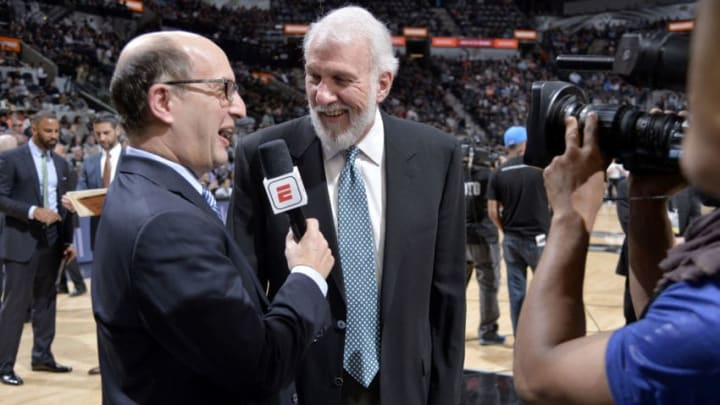 SAN ANTONIO, TX - MARCH 21: Jeff Van Gundy talks to Head Coach Gregg Popovich of the San Antonio Spurs during the game against the Washington Wizards on March 21, 2018 at the AT