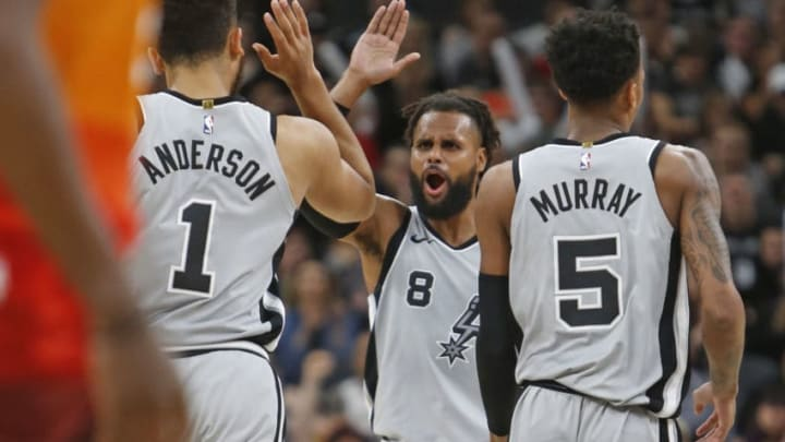 SAN ANTONIO,TX - MARCH 23 : Patty Mills #8 of the San Antonio Spurs high fives Kyle Anderson #1 of the San Antonio Spurs after a basket against the Utah Jazz at AT&T Center on March 23, 2018 in San Antonio, Texas. NOTE TO USER: User expressly acknowledges and agrees that , by downloading and or using this photograph, User is consenting to the terms and conditions of the Getty Images License Agreement. (Photo by Ronald Cortes/Getty Images)