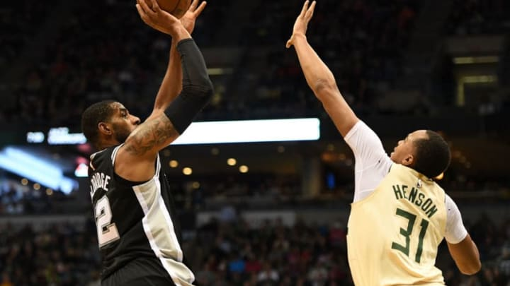 MILWAUKEE, WI - MARCH 25: LaMarcus Aldridge #12 of the San Antonio Spurs shoots over John Henson #31 of the Milwaukee Bucks during the first half of a game at the Bradley Center on March 25, 2018 in Milwaukee, Wisconsin. NOTE TO USER: User expressly acknowledges and agrees that, by downloading and or using this photograph, User is consenting to the terms and conditions of the Getty Images License Agreement. (Photo by Stacy Revere/Getty Images)