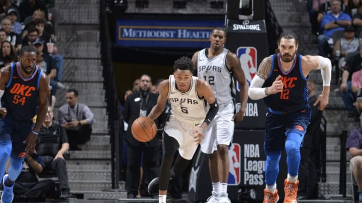 SAN ANTONIO, TX - MARCH 29: Dejounte Murray #5 of the San Antonio Spurs handles the ball against the Oklahoma City Thunder on March 29, 2018 at the AT&T Center in San Antonio, Texas. NOTE TO USER: User expressly acknowledges and agrees that, by downloading and or using this photograph, user is consenting to the terms and conditions of the Getty Images License Agreement. Mandatory Copyright Notice: Copyright 2018 NBAE (Photos by Mark Sobhani/NBAE via Getty Images)
