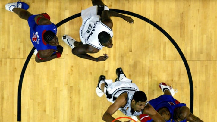 SAN ANTONIO - JUNE 23: Tim Duncan #21 of the San Antonio Spurs and Chauncey Billups #1 of the Detroit Pistons go after a rebound in the first half of Game seven of the 2005 NBA Finals at SBC Center on June 23, 2005 in San Antonio, Texas. The Spurs defeated the Pistons 81-74 and win the NBA Championship series 4-3. NOTE TO USER: User expressly acknowledges and agrees that, by downloading and/or using this Photograph, user is consenting to the terms and conditions of the Getty Images License Agreement (Photo by Ronald Martinez/Getty Images)
