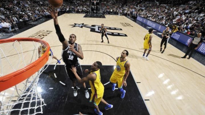 SAN ANTONIO, TX - MARCH 19: LaMarcus Aldridge #12 of the San Antonio Spurs shoots the ball against the Golden State Warriors on March 19, 2018 at the AT&T Center in San Antonio, Texas. NOTE TO USER: User expressly acknowledges and agrees that, by downloading and or using this photograph, user is consenting to the terms and conditions of the Getty Images License Agreement. Mandatory Copyright Notice: Copyright 2018 NBAE (Photos by Mark Sobhani/NBAE via Getty Images)