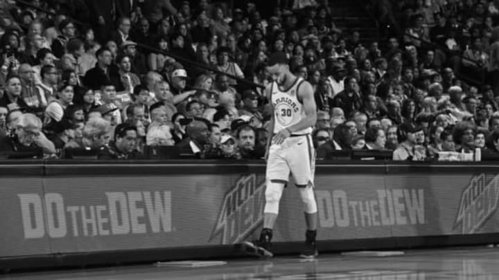 OAKLAND, CA – MARCH 23: Stephen Curry #30 of the Golden State Warriors looks on during the game against the Atlanta Hawks on March 23, 2018 at ORACLE Arena in Oakland, California. NOTE TO USER: User expressly acknowledges and agrees that, by downloading and or using this photograph, user is consenting to the terms and conditions of Getty Images License Agreement. Mandatory Copyright Notice: Copyright 2018 NBAE (Photo by Noah Graham/NBAE via Getty Images)