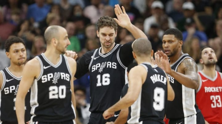 SAN ANTONIO,TX - APRIL 1 : Pau Gasol #16 of the San Antonio Spurs high fives teammates after a basket against the Houston Rockets at AT&T Center on April 1 , 2018 in San Antonio, Texas. NOTE TO USER: User expressly acknowledges and agrees that , by downloading and or using this photograph, User is consenting to the terms and conditions of the Getty Images License Agreement. (Photo by Ronald Cortes/Getty Images)