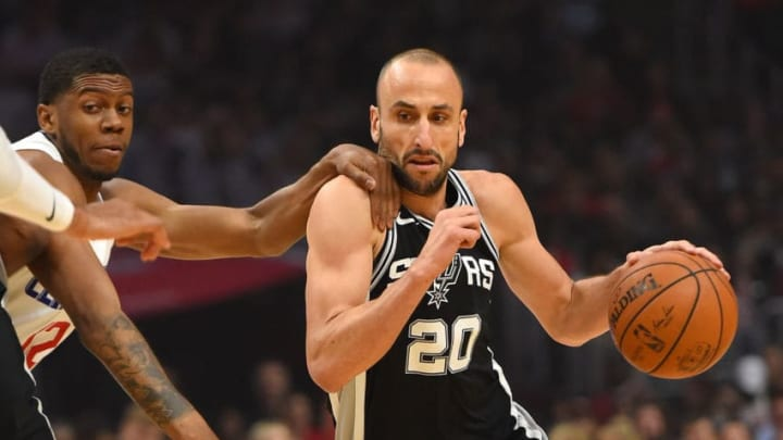LOS ANGELES, CA - APRIL 03: Tyrone Wallace #12 of the Los Angeles Clippers fouls Manu Ginobili #20 of the San Antonio Spurs as he drives to the basket in the first half of the game at Staples Center on April 3, 2018 in Los Angeles, California. NOTE TO USER: User expressly acknowledges and agrees that, by downloading and or using this photograph, User is consenting to the terms and conditions of the Getty Images License Agreement. (Photo by Jayne Kamin-Oncea/Getty Images)