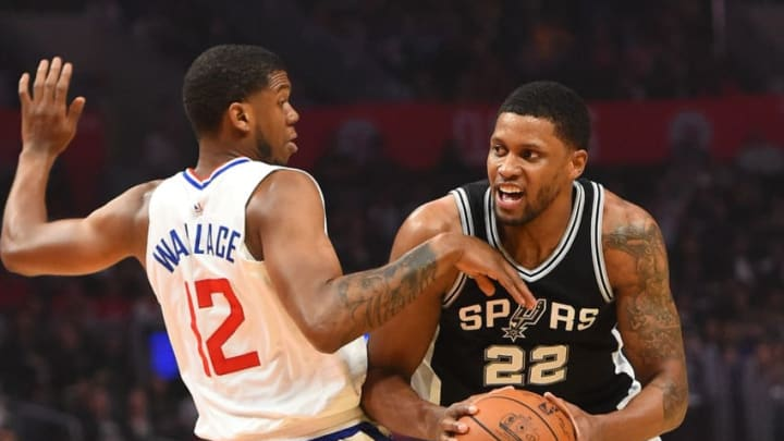 LOS ANGELES, CA - APRIL 03: Rudy Gay #22 of the San Antonio Spurs is fouled by Tyrone Wallace #12 of the Los Angeles Clippers as he drives to the basket in the first half of the game at Staples Center on April 3, 2018 in Los Angeles, California. NOTE TO USER: User expressly acknowledges and agrees that, by downloading and or using this photograph, User is consenting to the terms and conditions of the Getty Images License Agreement. (Photo by Jayne Kamin-Oncea/Getty Images)