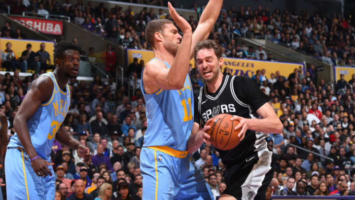 LOS ANGELES, CA - APRIL 4: Pau Gasol #16 of the San Antonio Spurs handles the ball against Brook Lopez #11 of the Los Angeles Lakers on April 4, 2018 at STAPLES Center in Los Angeles, California. NOTE TO USER: User expressly acknowledges and agrees that, by downloading and/or using this Photograph, user is consenting to the terms and conditions of the Getty Images License Agreement. Mandatory Copyright Notice: Copyright 2018 NBAE (Photo by Andrew D. Bernstein/NBAE via Getty Images)