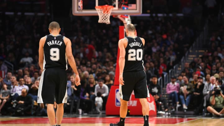 LOS ANGELES, CA - APRIL 03: San Antonio Spurs Guard Tony Parker (9) and San Antonio Spurs Forward Manu Ginobili (20) look on during an NBA game between the San Antonio Spurs and the Los Angeles Clippers on April 3, 2018 at STAPLES Center in Los Angeles, CA. (Photo by Brian Rothmuller/Icon Sportswire via Getty Images)