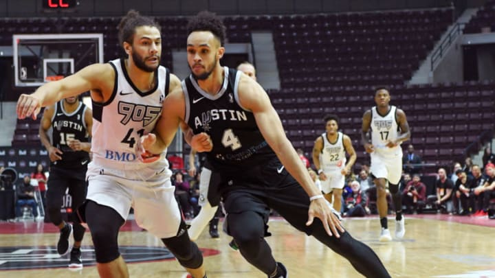 MISSISSAUGA, CANADA - APRIL 10: Derrick White #4 of the Austin Spurs handles the ball against the Raptors 905 during Game Two of the NBA G-League Finals on April 10, 2018 at the Hershey Centre in Mississauga, Ontario, Canada. NOTE TO USER: User expressly acknowledges and agrees that, by downloading and/or using this photograph, user is consenting to the terms and conditions of the Getty Images License Agreement. Mandatory Copyright Notice: Copyright 2018 NBAE (Photo by Ron Turenne/NBAE via Getty Images)