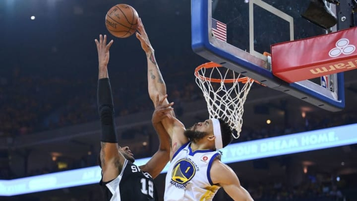 OAKLAND, CA - APRIL 14: JaVale McGee #1 of the Golden State Warriors blocks the shot of LaMarcus Aldridge #12 of the San Antonio Spurs in the first quarter during Game One of the first round of the 2018 NBA Playoff at ORACLE Arena on April 14, 2018 in Oakland, California. NOTE TO USER: User expressly acknowledges and agrees that, by downloading and or using this photograph, User is consenting to the terms and conditions of the Getty Images License Agreement. (Photo by Thearon W. Henderson/Getty Images)