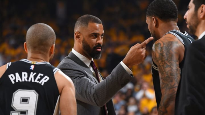 OAKLAND, CA - APRIL 14: Assistant Coach Ime Udoka of the San Antonio Spurs coaches during the game against the Golden State Warriors in Game One of Round One during the 2018 NBA Playoffs on April 14, 2018 at ORACLE Arena in Oakland, California. NOTE TO USER: User expressly acknowledges and agrees that, by downloading and or using this photograph, user is consenting to the terms and conditions of Getty Images License Agreement. Mandatory Copyright Notice: Copyright 2018 NBAE (Photo by Andrew D. Bernstein/NBAE via Getty Images)