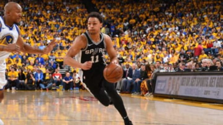 OAKLAND, CA – APRIL 14: Bryn Forbes #11 of the San Antonio Spurs handles the ball against the Golden State Warriors in Game One of Round One during the 2018 NBA Playoffs on April 14, 2018 at ORACLE Arena in Oakland, California. NOTE TO USER: User expressly acknowledges and agrees that, by downloading and or using this photograph, user is consenting to the terms and conditions of Getty Images License Agreement. Mandatory Copyright Notice: Copyright 2018 NBAE (Photo by Andrew D. Bernstein/NBAE via Getty Images)