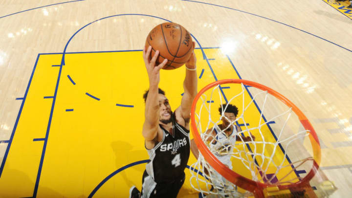 OAKLAND, CA - APRIL 14: Derrick White #4 of the San Antonio Spurs goes to the basket against the Golden State Warriors in Game One of Round One of the 2018 NBA Playoffs on April 14, 2018 at ORACLE Arena in Oakland, California. NOTE TO USER: User expressly acknowledges and agrees that, by downloading and or using this photograph, user is consenting to the terms and conditions of Getty Images License Agreement. Mandatory Copyright Notice: Copyright 2018 NBAE (Photo by Noah Graham/NBAE via Getty Images)