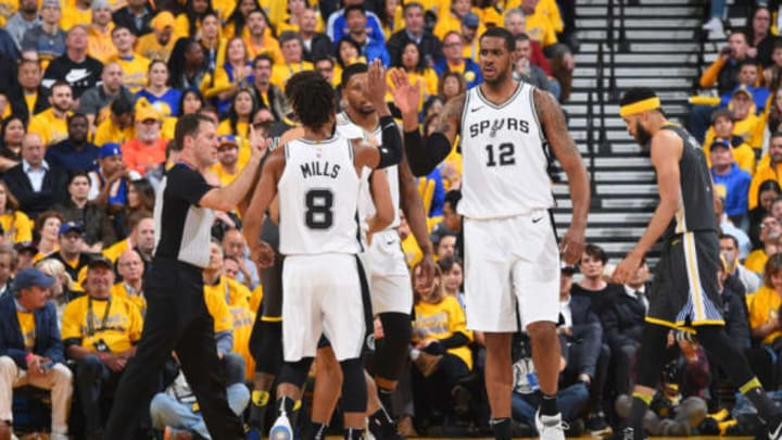 OAKLAND, CA – APRIL 16: LaMarcus Aldridge #12 and Patty Mills #8 of the San Antonio Spurs high five during the game against the Golden State Warriors in Game Two of Round One of the 2018 NBA Playoffs on April 16, 2018 at ORACLE Arena in Oakland, California. NOTE TO USER: User expressly acknowledges and agrees that, by downloading and or using this photograph, user is consenting to the terms and conditions of Getty Images License Agreement. Mandatory Copyright Notice: Copyright 2018 NBAE (Photo by Andrew D. Bernstein/NBAE via Getty Images)