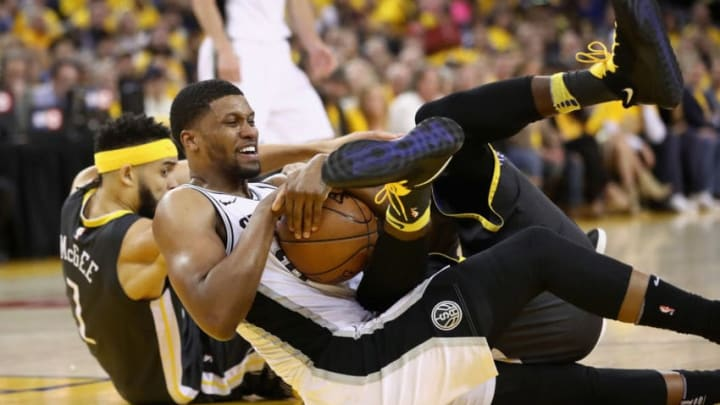 OAKLAND, CA - APRIL 16: Rudy Gay #22 of the San Antonio Spurs scrambles for a loose ball against JaVale McGee #1 and Draymond Green #23 of the Golden State Warriors during Game 2 of Round 1 of the 2018 NBA Playoffs at ORACLE Arena on April 16, 2018 in Oakland, California. NOTE TO USER: User expressly acknowledges and agrees that, by downloading and or using this photograph, User is consenting to the terms and conditions of the Getty Images License Agreement. (Photo by Ezra Shaw/Getty Images)