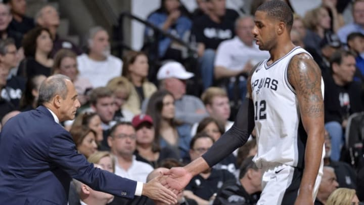 SAN ANTONIO, TX - APRIL 19: Assistant Coach Ettore Messina and LaMarcus Aldridge #12 of the San Antonio Spurs during Game Three of the Western Conference Quarterfinals against the Golden State Warriorsin the 2018 NBA Playoffs on April 19, 2018 at the AT&T Center in San Antonio, Texas. NOTE TO USER: User expressly acknowledges and agrees that, by downloading and/or using this photograph, user is consenting to the terms and conditions of the Getty Images License Agreement. Mandatory Copyright Notice: Copyright 2018 NBAE (Photos by Mark Sobhani/NBAE via Getty Images)