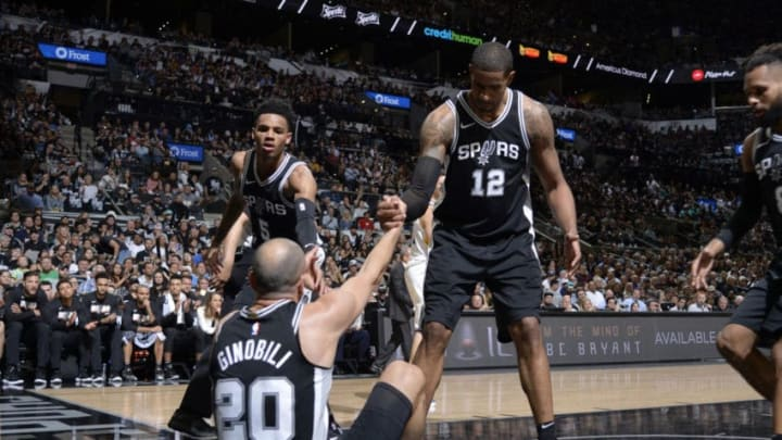 SAN ANTONIO, TX - APRIL 22: Dejounte Murray #5 and LaMarcus Aldridge #12 help up Manu Ginobili #20 of the San Antonio Spurs in Game Four of the Western Conference Quarterfinals against the Golden State Warriors during the 2018 NBA Playoffs on April 22, 2018 at the AT&T Center in San Antonio, Texas. NOTE TO USER: User expressly acknowledges and agrees that, by downloading and/or using this photograph, user is consenting to the terms and conditions of the Getty Images License Agreement. Mandatory Copyright Notice: Copyright 2018 NBAE (Photos by Mark Sobhani/NBAE via Getty Images)
