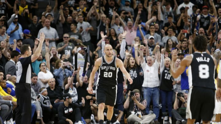 SAN ANTONIO,TX - APRIL 22 : Fans go wild after Manu Ginobili #20 of the San Antonio Spurs hit a three point shot late in fourth quarter against the Golden State Warriors in Game Four of Round One of the 2018 NBA Playoffs at AT&T Center on April 22 , 2018 in San Antonio, Texas. NOTE TO USER: User expressly acknowledges and agrees that , by downloading and or using this photograph, User is consenting to the terms and conditions of the Getty Images License Agreement. (Photo by Ronald Cortes/Getty Images)