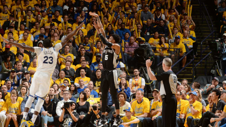 OAKLAND, CA – APRIL 24: Dejounte Murray #5 of the San Antonio Spurs shoots the ball against the Golden State Warriors Game Five of Round One of the 2018 NBA Playoffs (Photo by Noah Graham/NBAE via Getty Images)