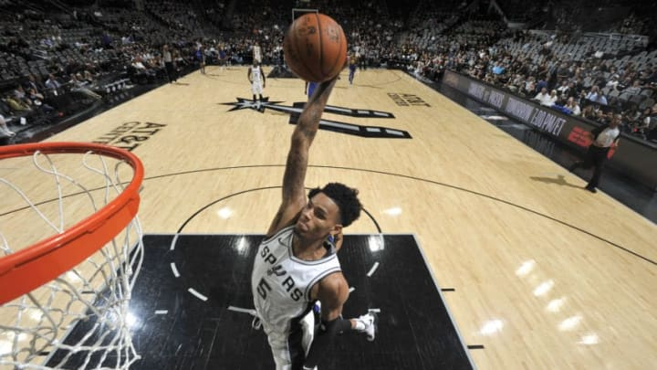 SAN ANTONIO, TX - APRIL 19: Dejounte Murray #5 of the San Antonio Spurs dunks the ball against the Golden State Warriors during Game Three of the Western Conference Quarterfinals in the 2018 NBA Playoffs on April 19, 2018 at the AT&T Center in San Antonio, Texas. NOTE TO USER: User expressly acknowledges and agrees that, by downloading and/or using this photograph, user is consenting to the terms and conditions of the Getty Images License Agreement. Mandatory Copyright Notice: Copyright 2018 NBAE (Photos by Mark Sobhani/NBAE via Getty Images)