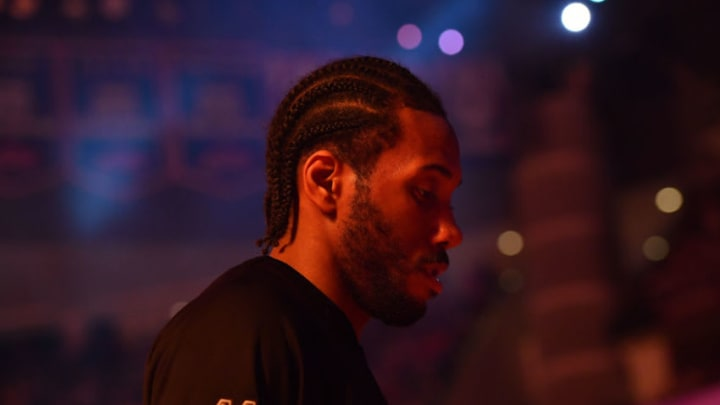HOUSTON, TX - MAY 7: Kawhi Leonard #2 of the San Antonio Spurs stands for a moment of silence for the National Anthem before the game against the Houston Rockets during Game Four of the Western Conference Semifinals of the 2017 Playoffs on May 7, 2017 at the Toyota Center in Houston, Texas. NOTE TO USER: User expressly acknowledges and agrees that, by downloading and or using this photograph, User is consenting to the terms and conditions of the Getty Images License Agreement. Mandatory Copyright Notice: Copyright 2017 NBAE (Photo by Jesse D. Garrabrant/NBAE via Getty Images)