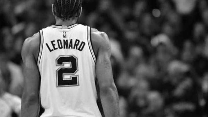 SAN ANTONIO, TX – MAY 9: Kawhi Leonard #2 of the San Antonio Spurs looks on during the game against the Houston Rockets during Game Five of the Western Conference Semifinals of the 2017 NBA Playoffs on May 9, 2017 at the AT&T Center in San Antonio, Texas. NOTE TO USER: User expressly acknowledges and agrees that, by downloading and or using this photograph, user is consenting to the terms and conditions of the Getty Images License Agreement. Mandatory Copyright Notice: Copyright 2017 NBAE (Photos by Jesse D. Garrabrant/NBAE via Getty Images)