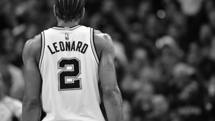 SAN ANTONIO, TX - MAY 9: Kawhi Leonard #2 of the San Antonio Spurs looks on during the game against the Houston Rockets during Game Five of the Western Conference Semifinals of the 2017 NBA Playoffs on May 9, 2017 at the AT&T Center in San Antonio, Texas. NOTE TO USER: User expressly acknowledges and agrees that, by downloading and or using this photograph, user is consenting to the terms and conditions of the Getty Images License Agreement. Mandatory Copyright Notice: Copyright 2017 NBAE (Photos by Jesse D. Garrabrant/NBAE via Getty Images)