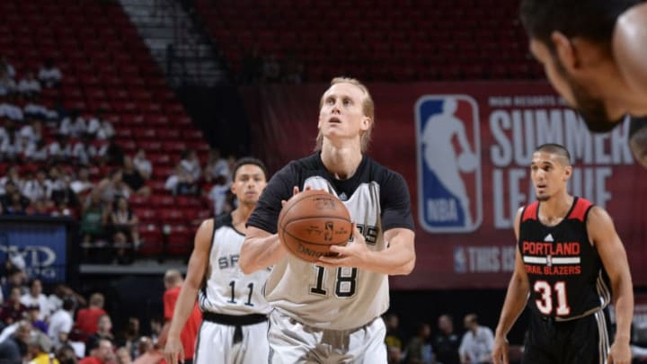 LAS VEGAS, NV - JULY 15: Jeff Ledbetter #18 of the San Antonio Spurs shoots a free throw against the Portland Trail Blazers during the Quarterfinals of the 2017 Summer League on July 15, 2017 at the Thomas & Mack Center in Las Vegas, Nevada. NOTE TO USER: User expressly acknowledges and agrees that, by downloading and or using this Photograph, user is consenting to the terms and conditions of the Getty Images License Agreement. Mandatory Copyright Notice: Copyright 2017 NBAE (Photo by David Dow/NBAE via Getty Images)