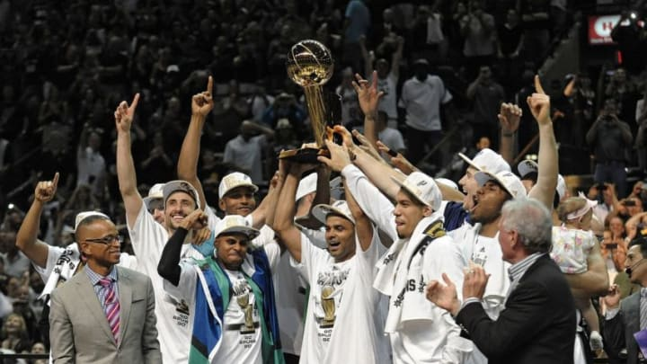 The San Antonio Spurs celebrate with the NBA Championship Larry O'Brien trophy after defeating the Miami Heat, 104-87, in Game 5 of the NBA Finals at the AT&T Center in San Antonio, Texas, on Sunday, June 15, 2014. (Michael Laughlin/Sun Sentinel/MCT via Getty Images)