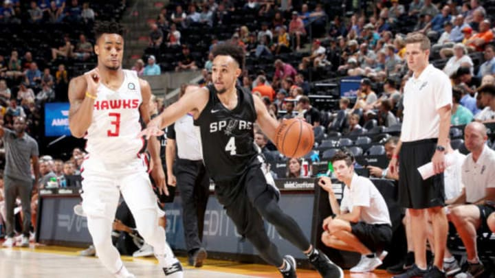 SALT LAKE CITY, UT – JULY 3: Derrick White #4 of the San Antonio Spurs handles the ball against the Atlanta Hawks during the 2018 Utah Summer League on July 3, 2018 at Vivint Smart Home Arena in Salt Lake City, Utah. NOTE TO USER: User expressly acknowledges and agrees that, by downloading and or using this Photograph, User is consenting to the terms and conditions of the Getty Images License Agreement. Mandatory Copyright Notice: Copyright 2018 NBAE (Photo by Joe Murphy/NBAE via Getty Images)