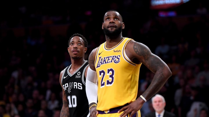 LOS ANGELES, CA – OCTOBER 22: DeMar DeRozan #10 of the San Antonio Spurs and LeBron James #23 of the Los Angeles Lakers watch a freethrow during a 143-142 Spurs win at Staples Center on October 22, 2018 in Los Angeles, California. (Photo by Harry How/Getty Images)