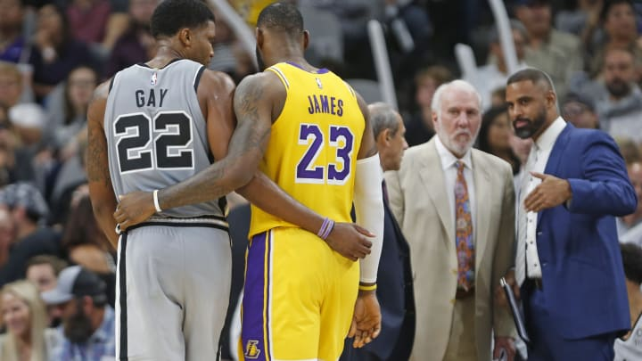 SAN ANTONIO, TX – OCTOBER 27: Rudy Gay #22 of the San Antonio Spurs and LeBron James #23 of the Los Angeles Lakers talk during a timeout at AT&T Center in 2018 in San Antonio, Texas. (Photo by Ronald Cortes/Getty Images)