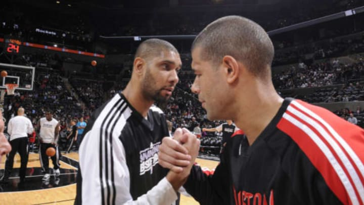 SAN ANTONIO, TX – JANUARY 29: Tim Duncan #21 of the San Antonio Spurs and Shane Battier #31 of the Houston Rockets embrace prior to the game at AT&T Center on January 29, 2011 in San Antonio, Texas. NOTE TO USER: User expressly acknowledges and agrees that, by downloading and or using this photograph, user is consenting to the terms and conditions of the Getty Images License Agreement. Mandatory Copyright Notice: Copyright 2011 NBAE (Photos by D. Clarke Evans/NBAE via Getty Images)